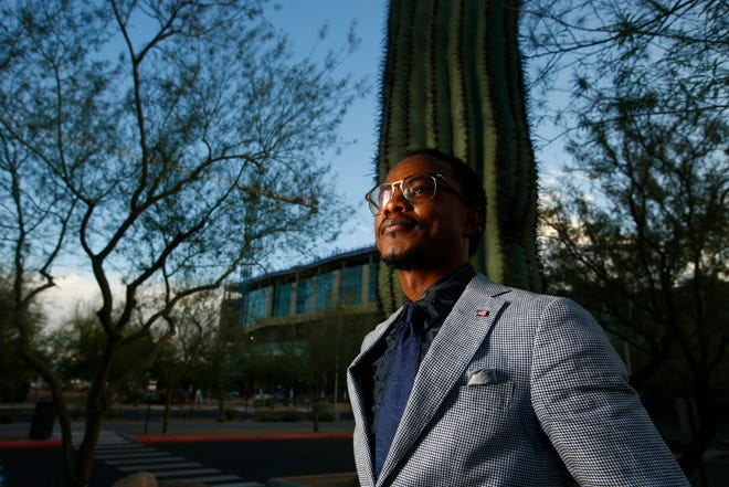Lester Myers, president of the Liberian Association of Arizona, poses for a picture outside his work in Phoenix on Feb. 12, 2021.