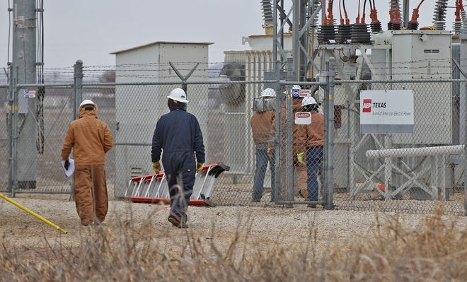 Employees with American Electric Power work on a substation near Grape Creek on Friday, Feb. 12, 2021 to prepare utility infrastructure for a winter storm expected to hit the region beginning Sunday.