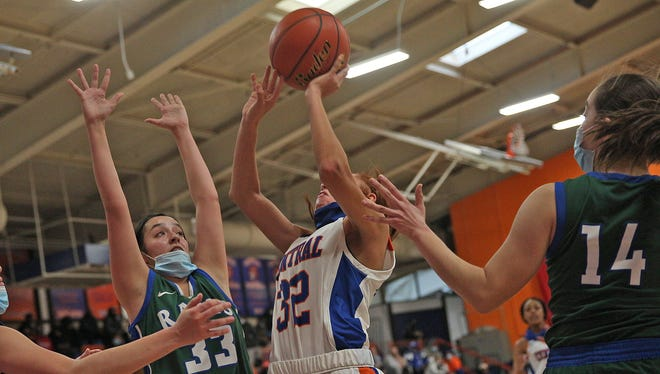 Central's Deandra Allen, center, drives to the basket during a game against El Paso Montwood on Friday, Feb. 12, 2021.