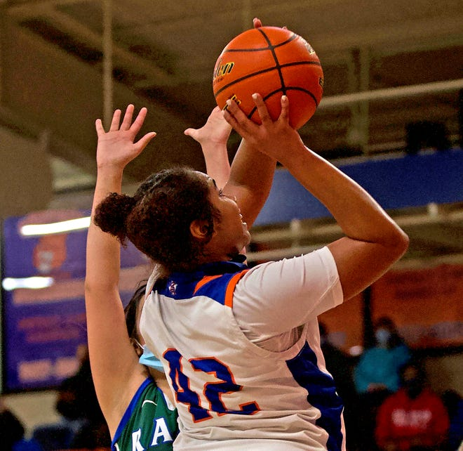 Central's Layla Young, center, drives to the basket during a game against El Paso Montwood on Friday, Feb. 12, 2021.