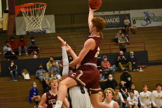 Cedar's Dallin Grant drives to the basket in a game against Pine View on Friday, February 12, 2021.