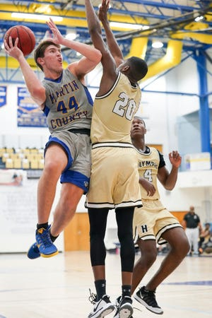 Martin County's Ryan Davis (44) goes for a 2-point basket as Olympic Heights defends in a District 13-6A boys basketball championship at Martin County High School on Friday, Feb. 12, 2021, in Stuart. Martin County won the championship, 62-39.