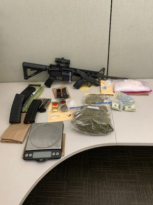 Deputies in Moorpark seized a pound of methamphetamine, small amounts of heroin and cocaine, a loaded semi-automatic handgun and an assault rifle during a search on Thursday.