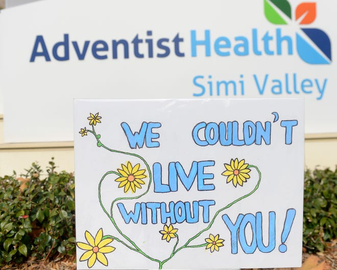 Members of the Chalice Unitarian Universalist Fellowship of the Conejo Valley placed 20 lawn signs with Valentine messages to health care workers at Adventist Health Simi Valley Hospital on Saturday, Feb. 13, 2021.