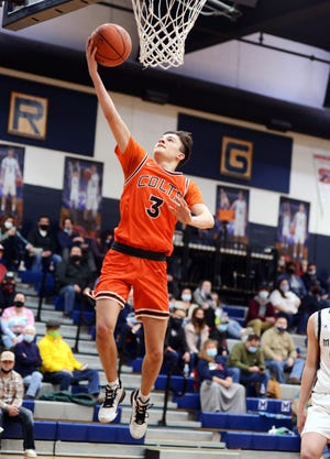 Jake Singleton flies in for a layup during Meadowbrook's 65-38 win against host Morgan on Dec. 12 in McConnelsville. Singleton hit five 3-pointers in a 19-point first quarter, part of a game-high 27 points.