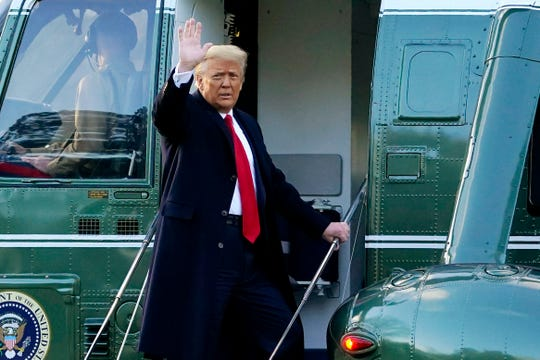 In this Wednesday, Jan. 20, 2021, file photo, President Donald Trump waves as he boards Marine One on the South Lawn of the White House, in Washington, en route to his Mar-a-Lago Florida Resort. Former President Trump has named two lawyers to his impeachment defense team, one day after it was revealed that the former president had parted ways with an earlier set of attorneys.