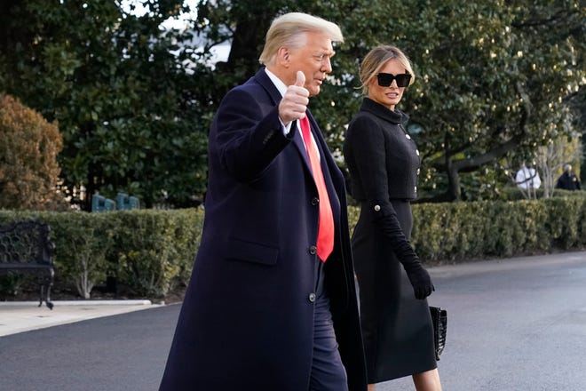 President Donald Trump and first lady Melania Trump walk to board Marine One on the South Lawn of the White House Jan. 20.