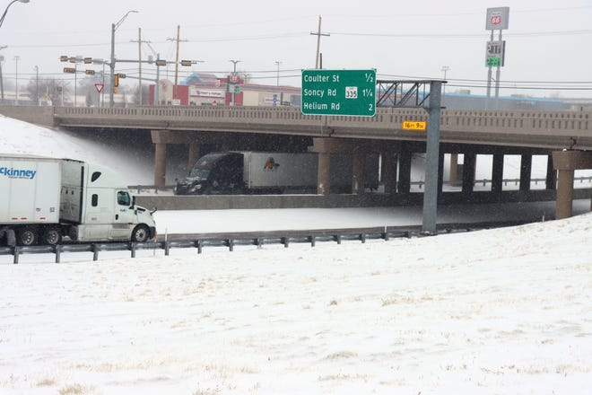 Traffic on I-40 was confined to one lane in each direction during Sunday's winter storm.