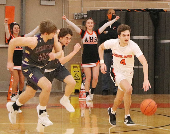 Ashland's Luke Denbow brings the ball up the court against Lexington during the Arrows' 57-42 win Saturday at Arrow Arena. Denbow scored his 1,000th career point in the win.