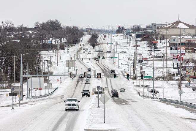 Winter kept its icy grip on the area with snow Sunday that slowed traffic on U.S. 75 in Bartlesville. That came on the heels of frosty temperatures and freezing precipitation -- with more still in the forecast.