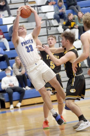 Boonville senior Lane West puts up a shot near the baseline in the second half Friday night against Sedalia Smith-Cotton.