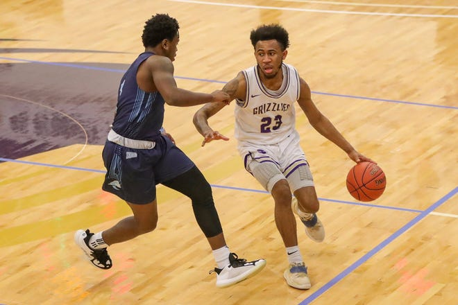 Butler Grizzlies' guard Keyon Thomas (23) dribbles up the court on Saturday, Feb. 13 at the Power Plant in El Dorado, Kansas. The Sophomore helped Butler to the 77-63 win.