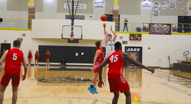 Andover Central's Skyler Clevenger (1!) attempts a shot over a McPherson defender on Saturday, Feb. 13. Clevenger scored 29 points to help the Jaguars to the win over Bullpups.