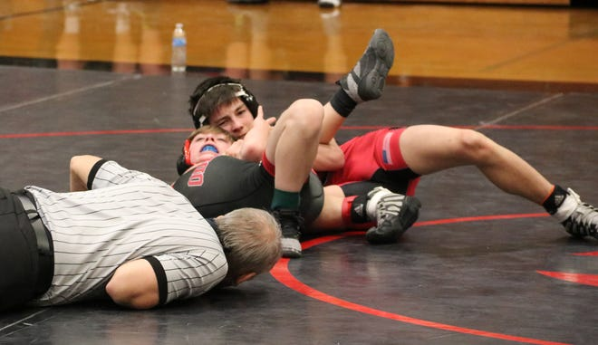 Chillicothe (Mo.) HS freshman Lane McCoy has Landon Scarborough of Odessa on his back on McCoy's way to a 2:07 win by fall in the third-place bout of the Class 2 District 7 boys' wrestling tournament in Chillicothe Saturday, Feb. 13 2021.
