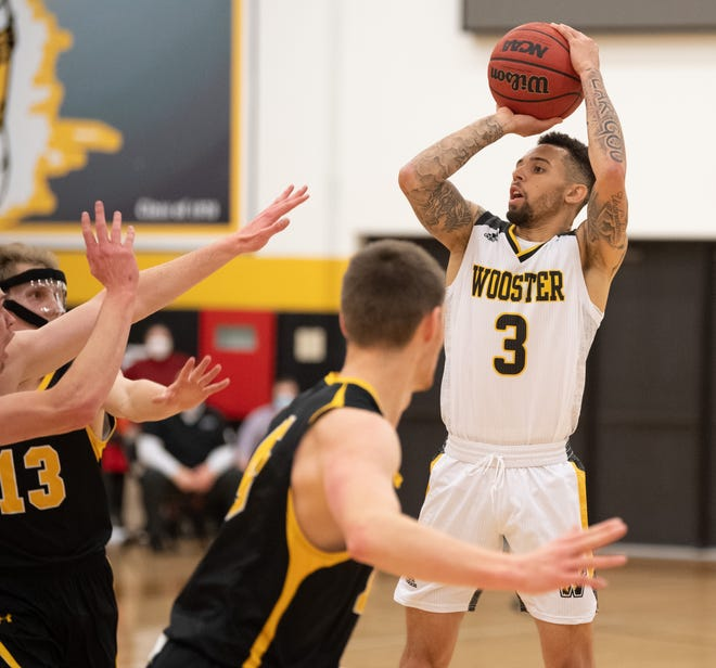 Keonn Scott fires over two DePauw defenders in The College of Wooster's 100-97 loss. Scott finished with 26 points.