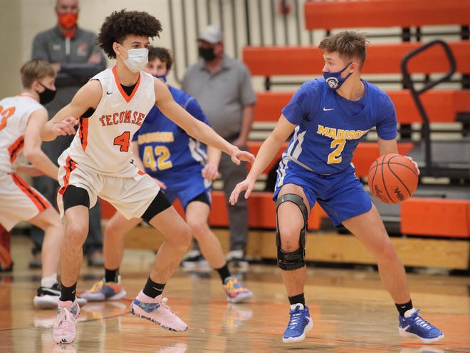 Madison's Max Palpant (2) moves with the ball as Tecumseh's TJ Bell (4) guards him during their game on Wednesday.