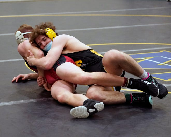 Adrian College 165-pounder Derrick Duval, right, grapples with Ohio Wesleyan's Ethan Laws during a dual meet on Feb. 5 at the Merillat Sport and Fitness Center. Duval went 2-1 at Saturday's MIIAA team championships where the Bulldogs finished second to Olivet.