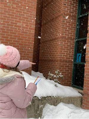 A participant in the upcoming town wide Scavenger Hunt taking place during February school vacation at the Rochester Public Library.