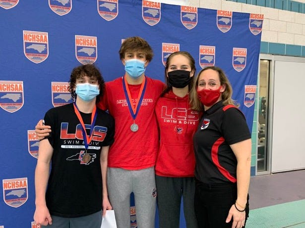 Lincoln Charter divers Davis Hutchinson, left, and Alex Givens, middle left, celebrate after their bronze and silver performances, respectively, at the 1A/2A swim meet. Emily Lesniak, middle right, was eighth in the girls diving event. With them is Lincoln Charter School administrator and coach Christy Hutchinson.