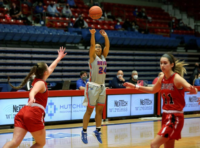 Hutchinson Community Tor'e Alford (24) shoots a 3-point shot against Allen County on Saturday during their game at the Sports Arena. HCC defeated Allen County 80-49. Alford scored five 3-pointers in the game.