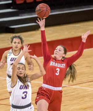 Bradley's Gabi Haack (3) puts up a long shot over Northern Iowa's Karli Rucker as time runs out in the first half Saturday, Feb. 13, 2021 at Renaissance Coliseum in Peoria. Haack sunk the shot to put the Braves up 42-21 at the half.