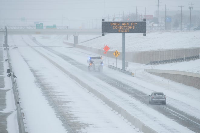 A sign cautions drivers traveling on I-27 on Sunday, Feb. 14, 2021, in Lubbock, Texas. [Justin Rex/For A-J Media]