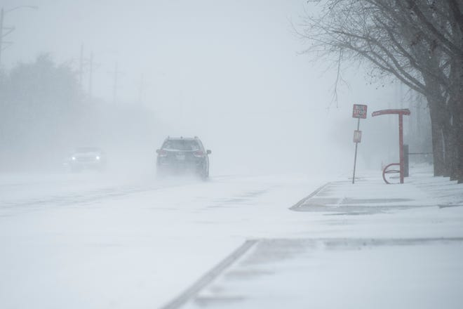 The snow falls on 4th Street on Sunday, Feb. 14, 2021, in Lubbock, Texas.
