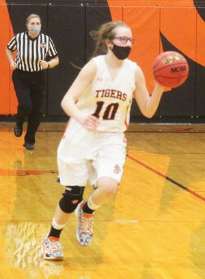 La Junta High School's Sierra Reisch pushes the ball upcourt in the Tigers' 59-34 win over Woodland Park Thursday at Tiger Gym.