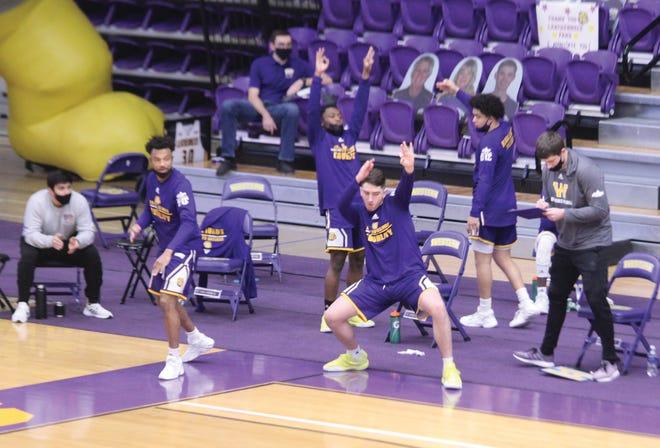 WIU bench celebrates a basket.