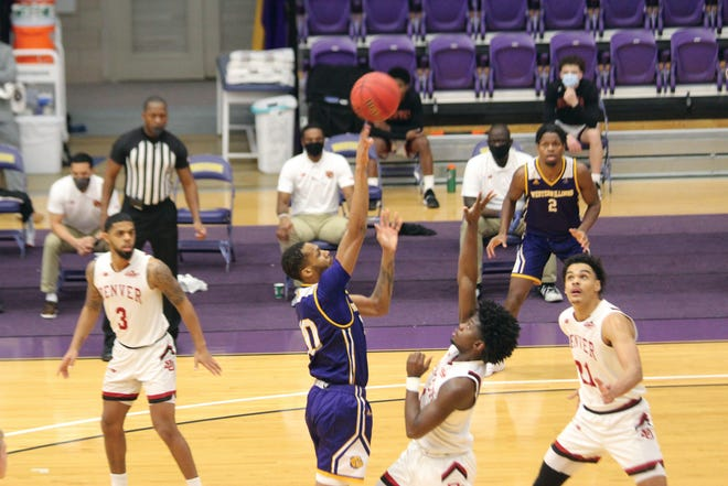 Cameron Burrell hits a jump hook during Saturday's game.