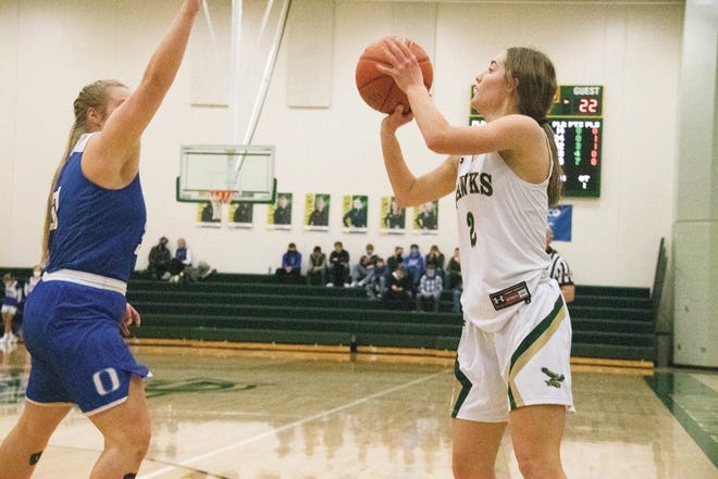 Ava Petersen looks to put up a shot for the Hawks during  the regional opener on Saturday, Feb. 13 in Woodward.