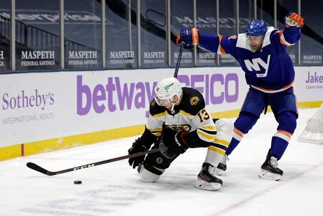 Bruins center Charlie Coyle controls the puck in front of New York Islanders defenseman Nick Leddy during the first period of Saturday's game in Uniondale, N.Y.