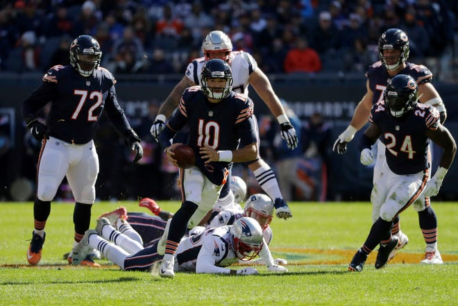 Bears quarterback Mitchell Trubisky scrambles out of the pocket during the game against the Patriots in October 2018 in Chicago.
