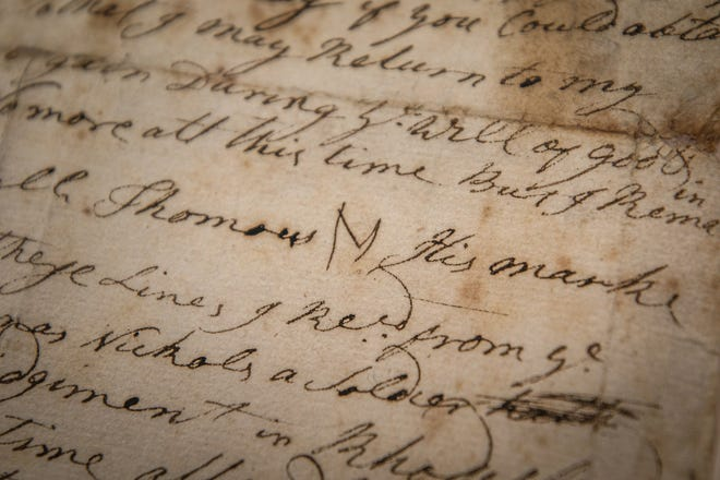 Revolutionary War soldier Thomas Nichols' letter was discovered by Patrick Donovan in a box of old artifacts at the Varnum Armory Museum in East Greenwich.