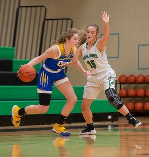 Hannah Mang of Lake Center Christian handles the basketball during a 58-54 win at Mogadore during the 2020-21 season.