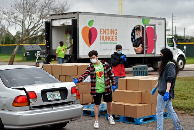 """All Faiths Food Bank holds a food distribution event at Ed Smith Stadium in Sarasota in February. All Faith's annual Campaign Against Summer Hunger aims to fill the """"hunger gap""""for children when schools are closed."""
