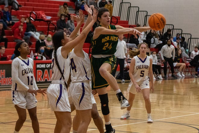 Savannah Country Day's Abby Nicholson (24) passes the ball in front of a group of Calvary Day players  on Saturday in the Region 3-A Private championship game at Savannah Christian. Savannah Country Day won 44-37.
