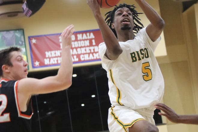 Oklahoma Baptist's Jarius Hicklen (5) glides in for a basket during a game against East Central in February.