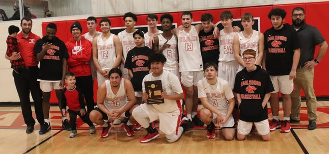 The Earlsboro Wildcats pose for a team shot after capturing a Class B district championship over the Asher Indians on Saturday.