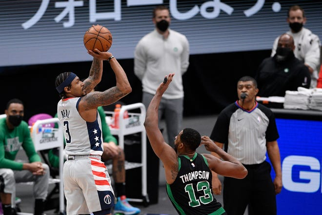 Washington Wizards guard Bradley Beal (3) shoots against Boston Celtics forward Tristan Thompson (13) during the first half of an NBA basketball game, Sunday, Feb. 14, 2021, in Washington.