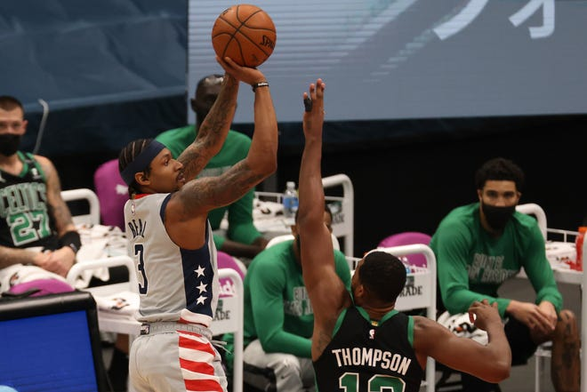 Wizards guard Bradley Beal shoots over Celtics forward Tristan Thompson during the first quarter Sunday in Washington.