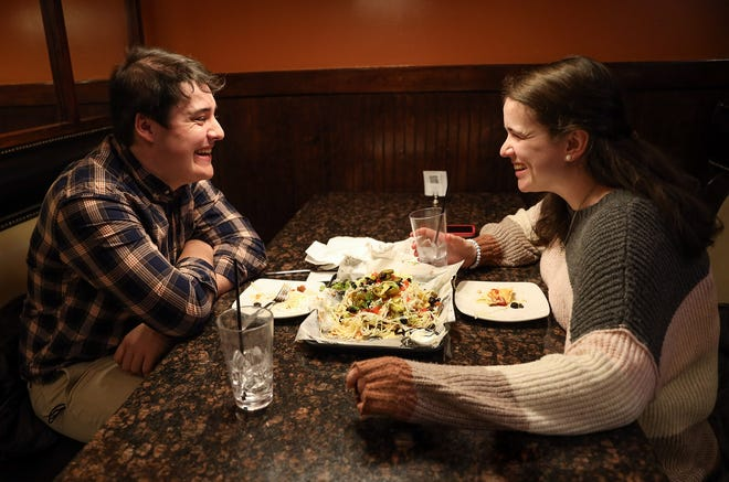 Regan Kahala, left, and Jen Mills exchange laughs during their dinner Sunday at  The Boynton Restaurant & Spirits in Worcester on Valentine's Day.