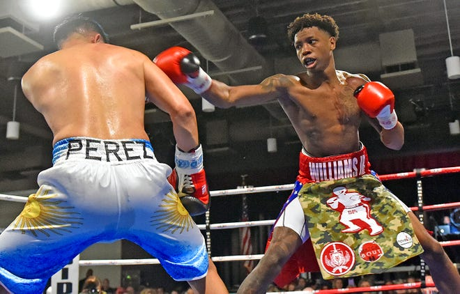 Unbeaten Michael Williams Jr., right, connects Feb. 13 during his welterweight fight against Diego Vicente Perez in Rumble by the River II at The Venue at Coosa Landing. Williams won by unanimous decision, and will be back in action in Gadsden on May 22 against Anthony Curtiss in Rumble by the River III.