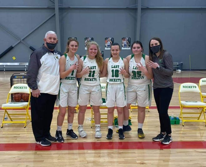 Conotton Valley girls basketball head coach Mike Angelozzi, Emily Siedel, Masyn Baker, Haley Myers, Alexis Vanderpool, and assistant coach Emily Baker.