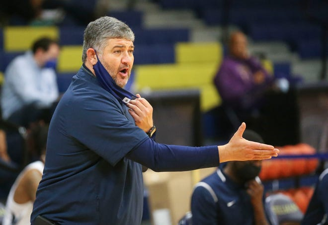 Stillman Head Coach John Teasley  gives directions to his team as they play Blue Mountain College at Stillman College Saturday, Feb. 13, 2021. [Staff Photo/Gary Cosby Jr.]