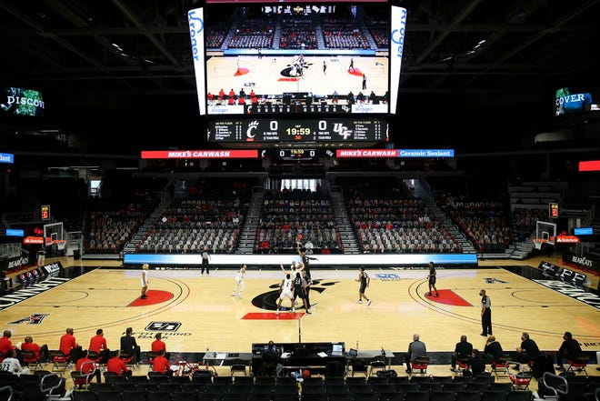 The Cincinnati Bearcats and the UCF Knights compete for the opening tip off in the first half of an NCAA men's college basketball game, Sunday, Feb. 14, 2021, at Fifth Third Arena in Cincinnati.