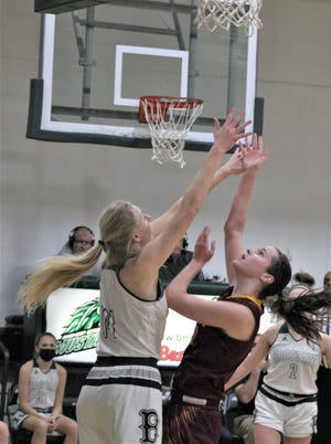 Cooper sophomore Whitney Lind shoots over Brossart senior Marie Kiefer as Cooper defeated Bishop Brossart 47-42 in KHSAA girls basketball Feb. 13, 2021, at Bishop Brossart High School, Alexandria, Ky. Brossart senior Marie Kiefer had 34 points and Cooper sophomore Whitney Lind 26.
