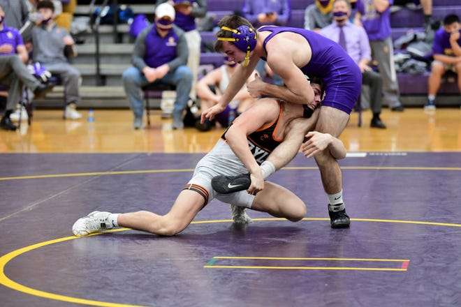 Ryle's Cole Thomas works to take down Jason Holden of Campbell County at 126 pounds at the Campbell County Wrestling Quad, Feb. 13, 2021.