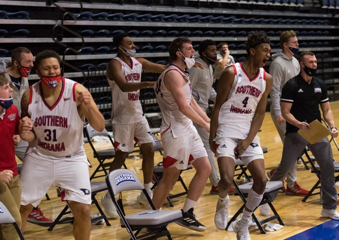 The University of Southern Indiana bench erupts as the Eagles play Drury on Feb. 13 at Screaming Eagles Arena.
