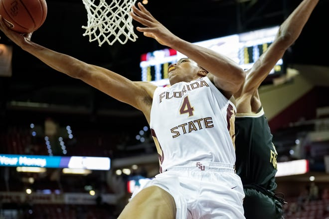 Florida State freshman point guard Scottie Barnes extends for a game-tying reverse layup with under one second remaining in regulation vs. the Wake Forest Demon Deacons at the Donald L. Tucker Civic Center in Tallahassee, FL., on Feb. 13, 2021.